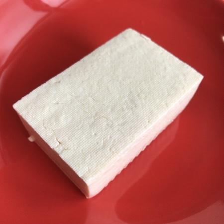 お母さん食堂 国産大豆100%使用木綿豆腐 【ファミリーマート】の中身画像